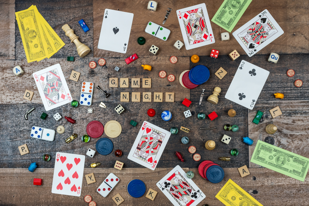 Overhead view of classic board game pieces on a wood tabletop