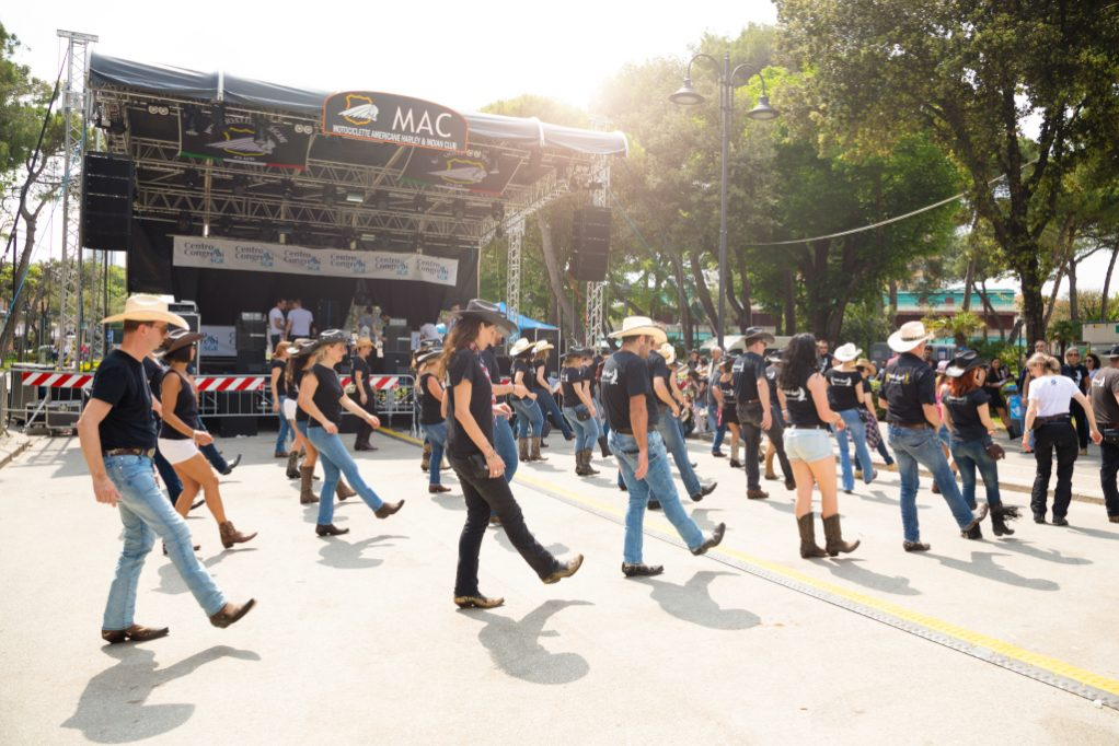 event team building outdoors line dance in costume